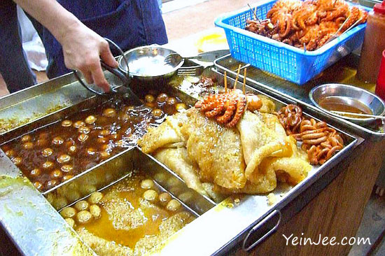 Curry fish ball and street food at Hong Kong Temple Street