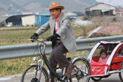 Former South Korean President Roh Moo-hyun cycling with grandchildren