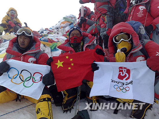 Chinese and Tibetan mountaineers at the top of Mount Everest