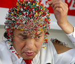Chinese piercing his head with 2008 needles
