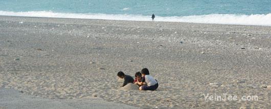 Kids playing at Qisingtan near Hualian city, Taiwan