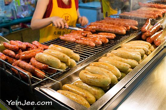Small sausage wrapped in big sausage at Shilin Night Market, Taipei, Taiwan