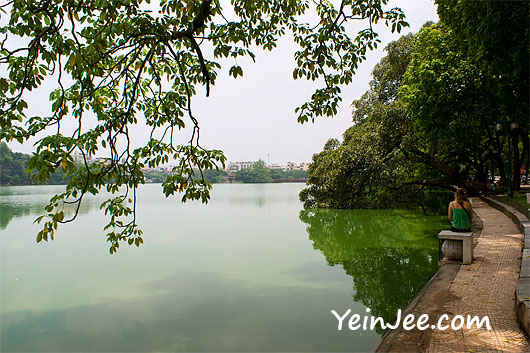 A foreign visitor at Hoan Kiem Lake in Hanoi, Vietnam