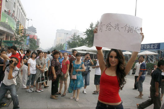 A lady offering free hugs in Beijing, China