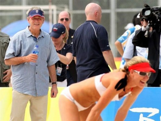 US president George Bush checking the women beach volleyball players at Beijing Olympics