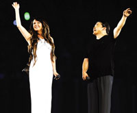 British singer Sarah Brightman and Chinese singer Liu Huan at Beijing Olympics opening ceremony