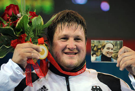 Picture of German weightlifter Matthias Steiner with his wife photo at Beijing Olympics 2008