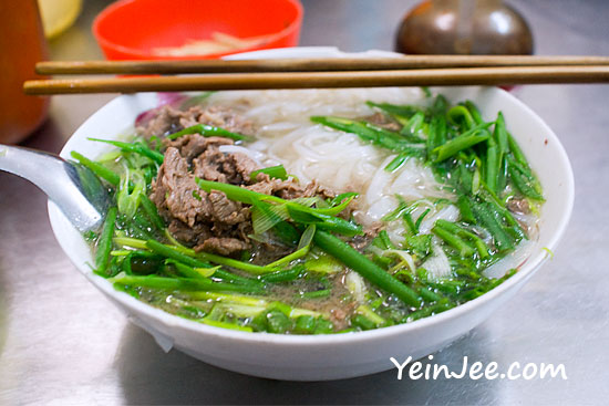 Traditional Vietnamese rice noodle soup at Pho Thin Restaurant in Hanoi