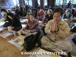 Korean parents praying for College Scholastic Ability Test