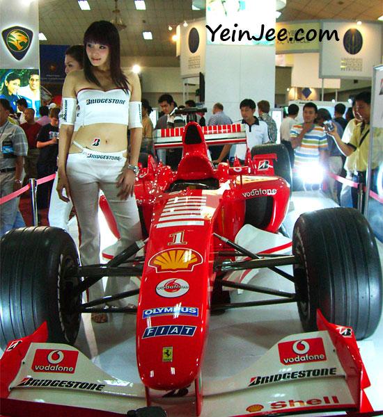 Bridgestone showgirl and Ferrari race car at KLIMS 2006