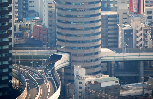 Picture of Gate Tower Building in Osaka, Japan, with a drive through highway