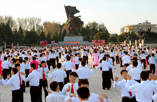 North Koreans celebrate Kim Jong-il re-election