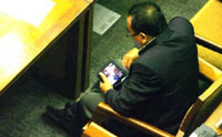 Indonesia politician watching blue movie at parliament
